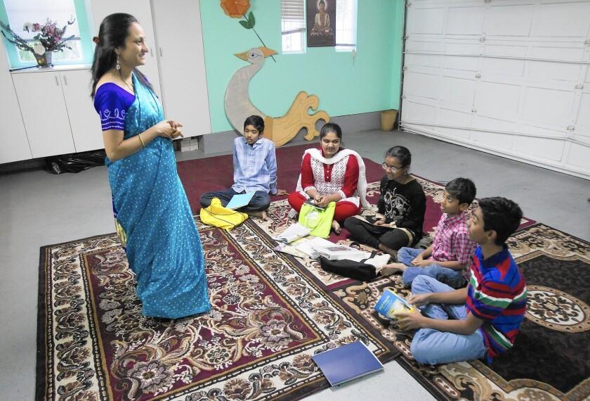 Vidya Tandanki hosts the Telugu Thota school in her Irvine home to teach children the ancient language.