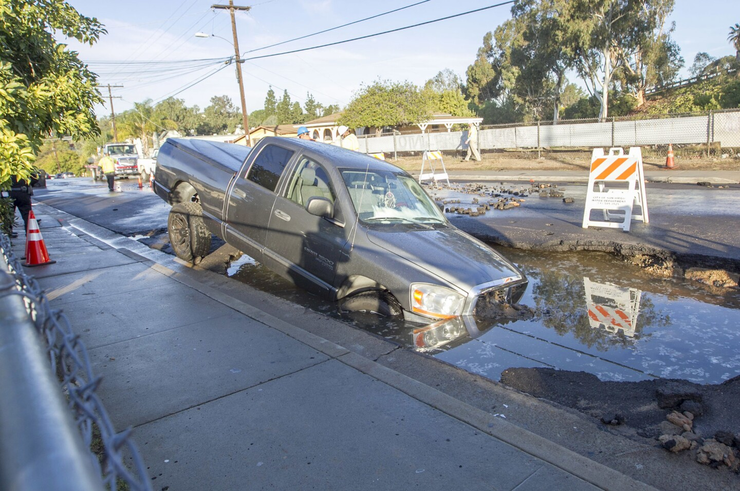 A water main break early Wednesday morning on Delta street in the Mountainview section of town opened a sinkhole that swallowed a pickup truck and flooded at least seven homes.
