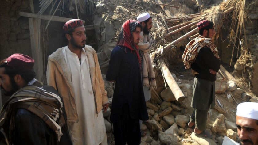 Pakistani students gather at a destroyed religious seminary belonging to the Haqqani network after a U.S. drone strike in the Hangu district of Khyber Pakhtunkhwa province on Nov. 21, 2013.
