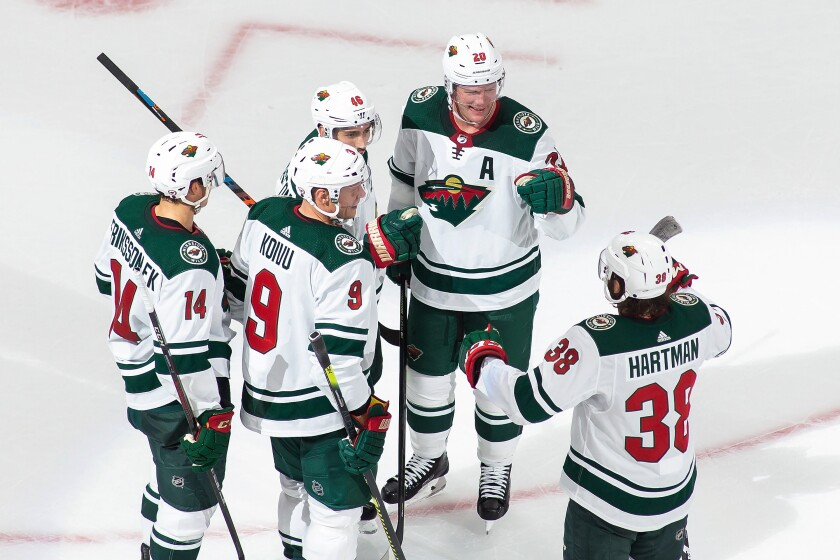 Minnesota Wild's Joel Eriksson Ek (14), Mikko Koivu (9), Jared Spurgeon (46), Ryan Suter (20) and Ryan Hartman (38) celebrate Spurgeon's goal against the Vancouver Canucks during the third period of an NHL hockey playoff game Sunday, Aug. 2, 2020, in Edmonton, Alberta. (Codie McLachlan/The Canadian Press via AP)