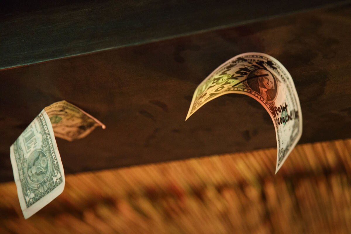 Dollar bills are stapled to the ceiling as tiki themed cocktails are served inside of the secret tiki bar PDTiki during weekend one of the three-day Coachella Valley Music and Arts Festival at the Empire Polo Grounds on Saturday, April 15, 2017 in Indio, Calif. Goldenvoice food and beverage director Nic Adler teamed with the bartenders at PDT (Please Don't Tell) in Manhattan, New York, to open a 35-person bar in the general admission area. An assortment of restaurants and chefs are providing unique food and crafted drink options for the festival. (Patrick T. Fallon/ For The Los Angeles Times)
