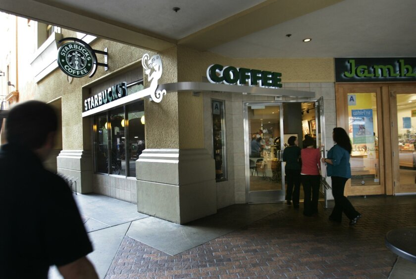 A Starbucks employee was injured early Thursday morning when a customer threw a cup of near boiling hot water or coffee at her in the store at the Horton Plaza shopping center downtown.