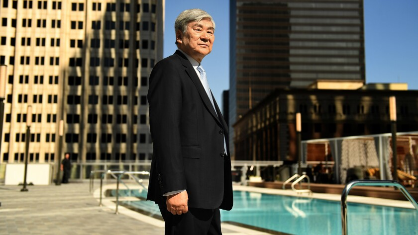 Yang Ho Cho, the man behind L.A.'s tallest building -- and the tallest building in the West -- stand