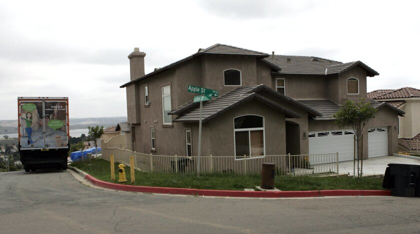 The parents of Reggie Bush (far left) lived in this Spring Valley house without paying rent, resulting in NCAA sanctions that have rocked the USC football program. Earnie Grafton / U-T