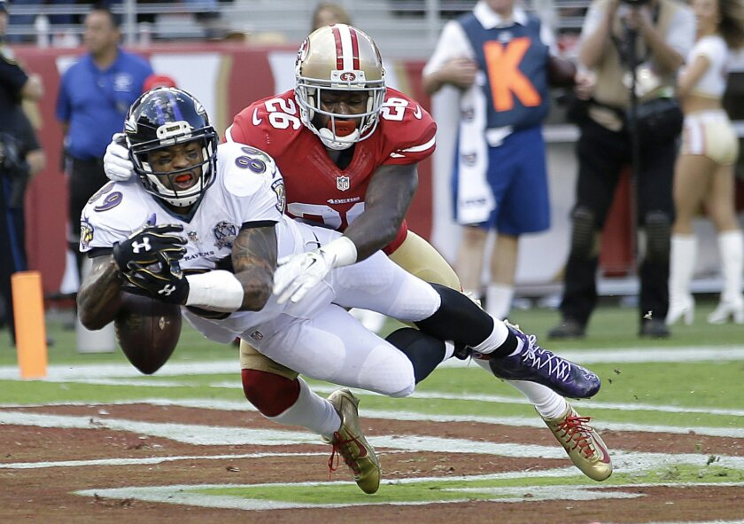 Baltimore Ravens wide receiver Steve Smith (89) drops a pass in the end zone in front of San Francisco 49ers cornerback Tramaine Brock (26) during the first half of an NFL football game in Santa Clara, Calif., Sunday, Oct. 18, 2015. (AP Photo/Marcio Jose Sanchez)