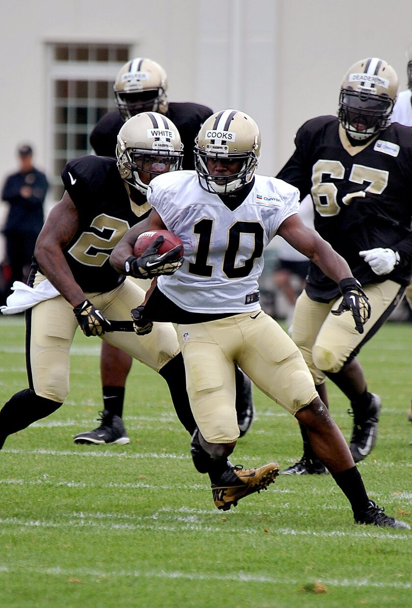 New Orleans Saints wide receiver Brandin Cooks (10) runs the ball during their NFL football training camp in White Sulphur Springs, W.Va., Saturday, Aug. 2, 2014. (AP Photo/Chris Tilley)