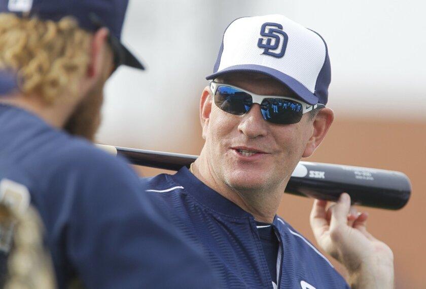 Padres pitching coach Darren Balsley talks to pitcher Andrew Cashner.
