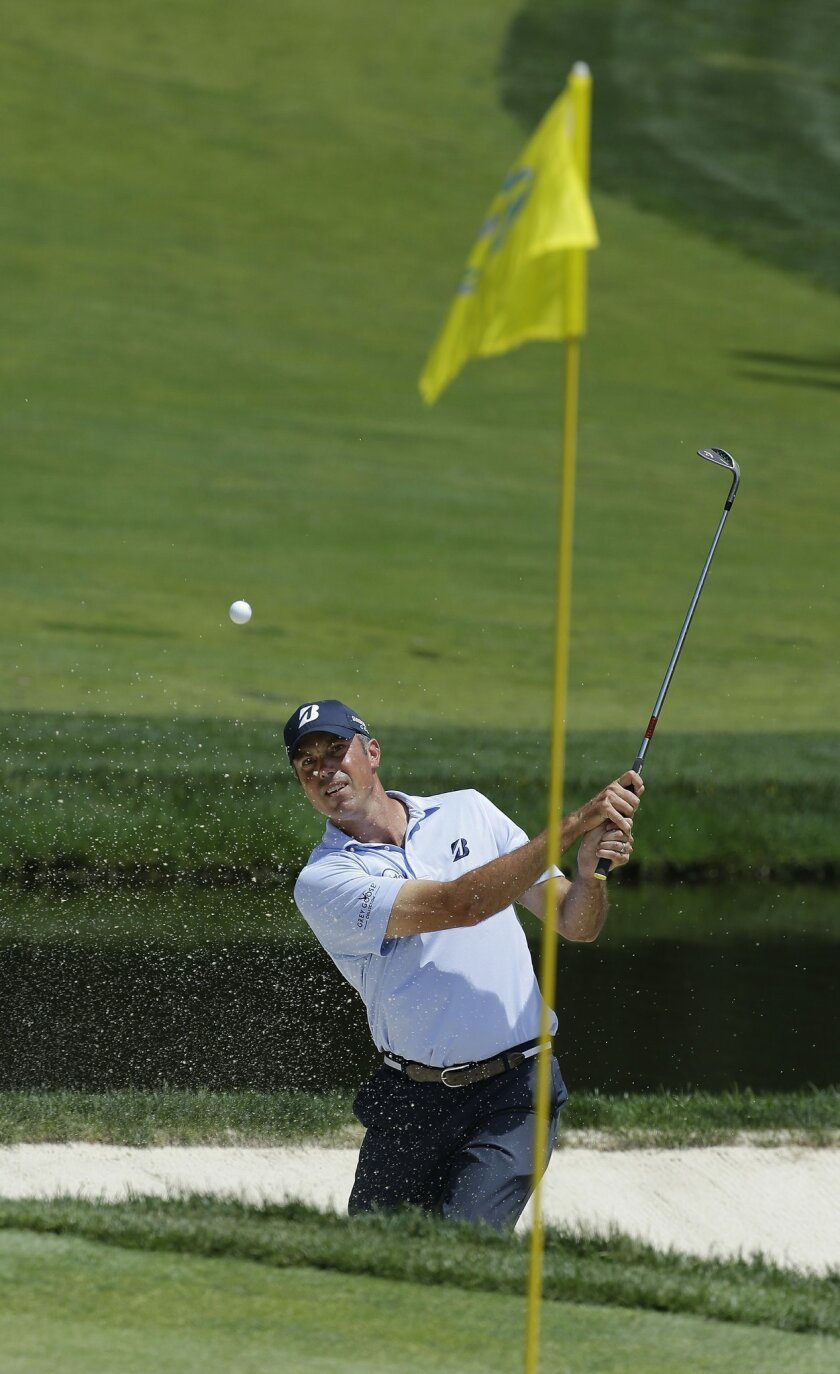 Matt Kuchar hits out of the bunker on the ninth hole during the second round of the Memorial golf tournament, Friday, June 3, 2016, in Dublin, Ohio. (AP Photo/Darron Cummings)