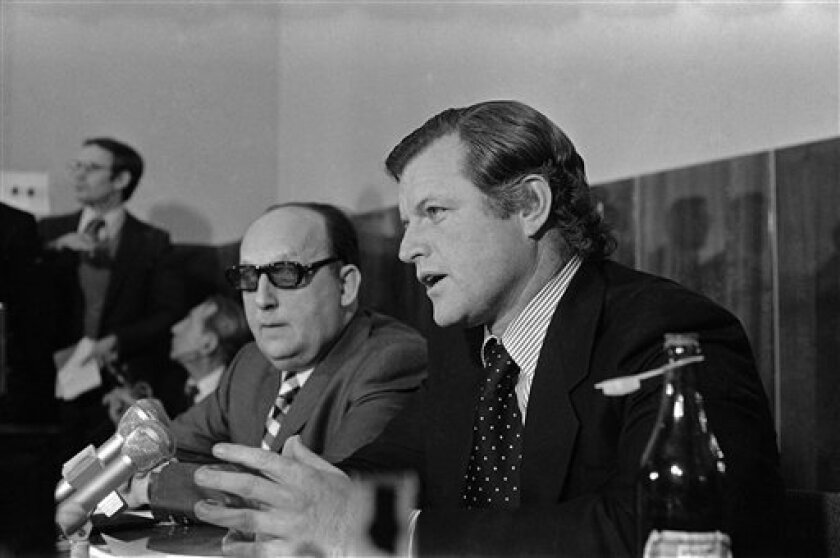 FILE - Georgi Arbatov, director of the Russiann institute which studies American policy , left, looks on as Sen. Edward M. Kennedy, D-Mass.,talks at the Soviet Union's U.S.A. Institute in Moscow Friday, April 19, 1974. Arbatov, a foreign policy adviser to Soviet presidents who served as the country's top America-watcher during the Cold War, died Friday Oct 1 2010. He was 87. (AP Photo/file)