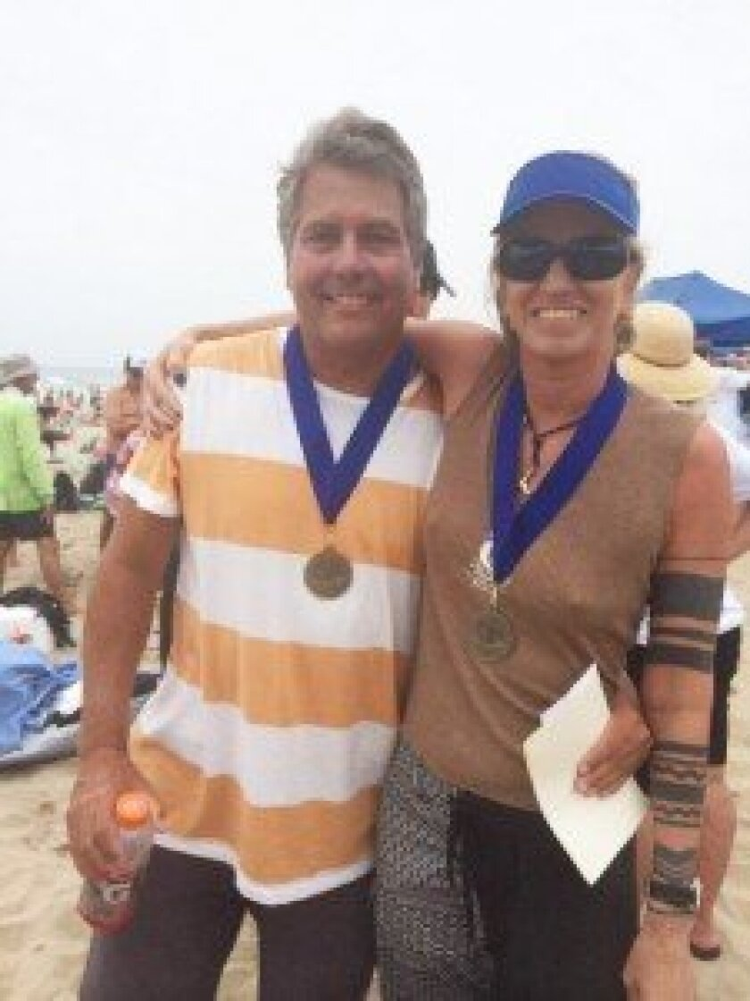 David Lane and Briguitte Linn Wiedemeyer with their gold medals at the 2014 International Bodysurfing Championships.