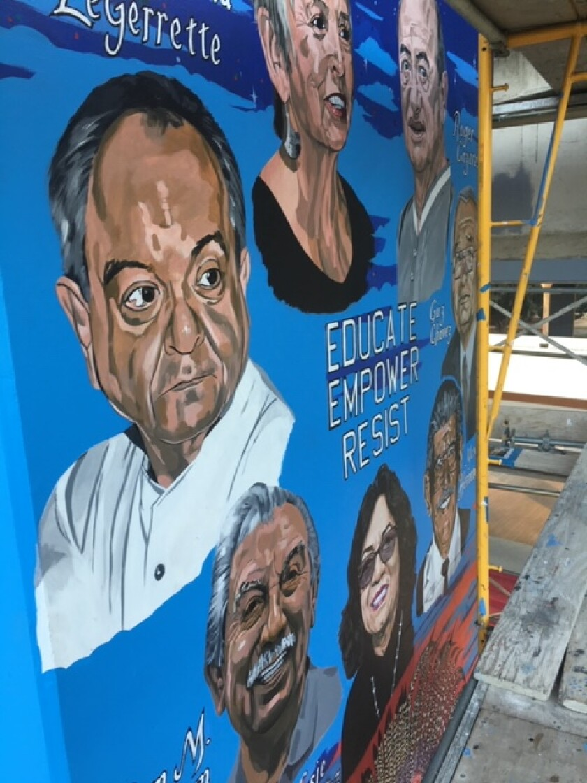 A new mural featuring community heroes is unveiled in Chicano Park