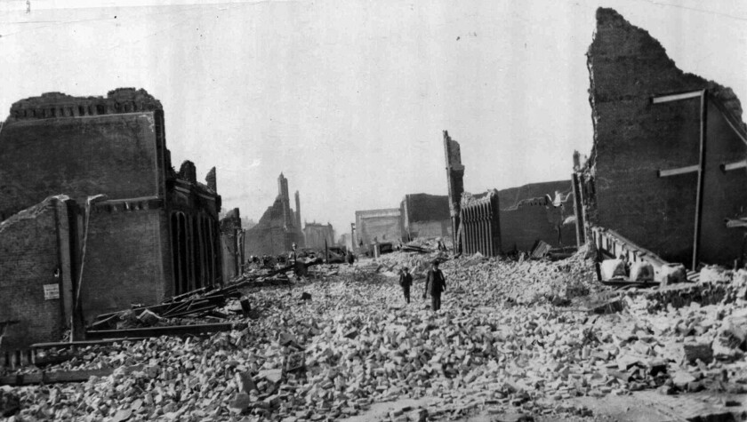 People walk through the rubble following the April 18, 1906 earthquake in San Francisco.