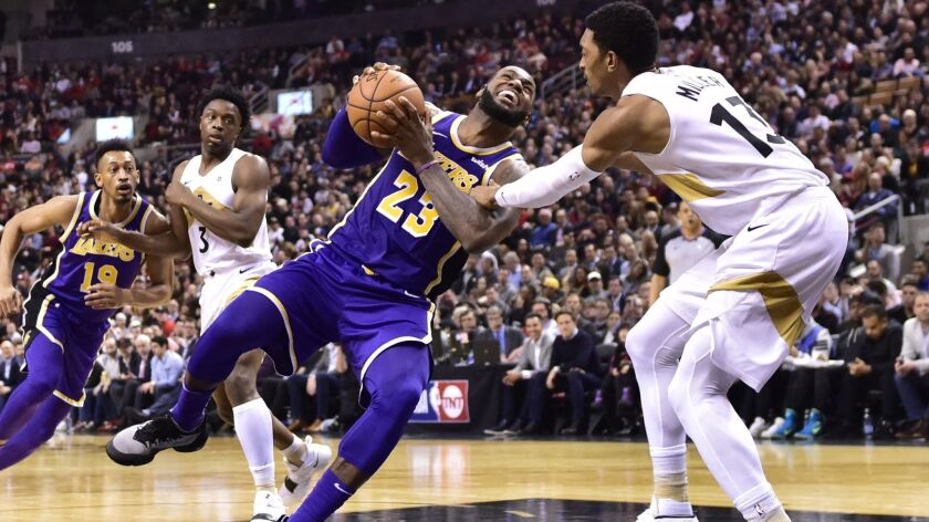Los Angeles Lakers forward LeBron James (23) starts to fall to the court after being fouled by Toron