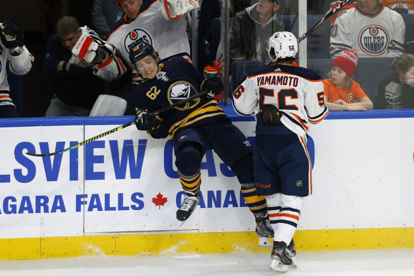 Buffalo Sabres defenseman Brandon Monyour (62) is checked by Edmonton Oilers forward Kailer Yamamoto (56) during the first period of an NHL hockey game Thursday, Jan. 2, 2020, in Buffalo, N.Y. (AP Photo/Jeffrey T. Barnes)