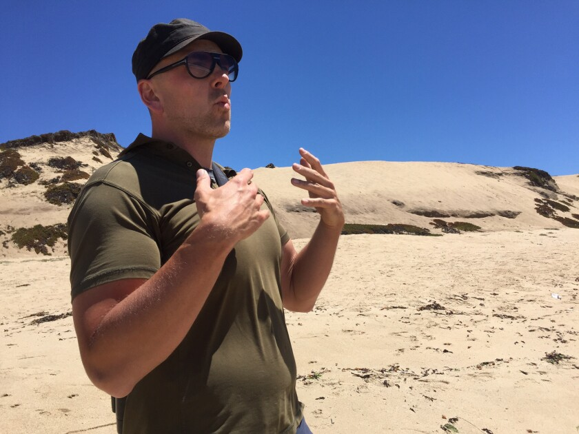 Blake Matheson, president of the Monterey Audubon Society, at the site of a proposed development in Sand City, Calif.