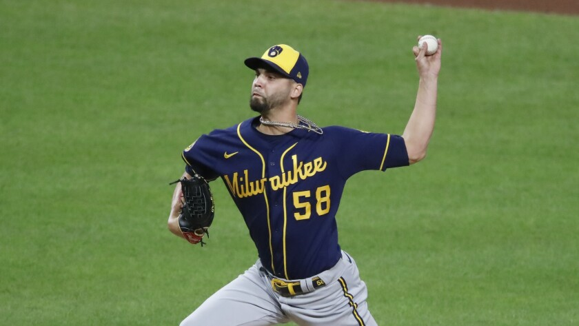 Álex Claudio delivers during a game between the Milwaukee Brewers and the Pittsburgh Pirates in August.