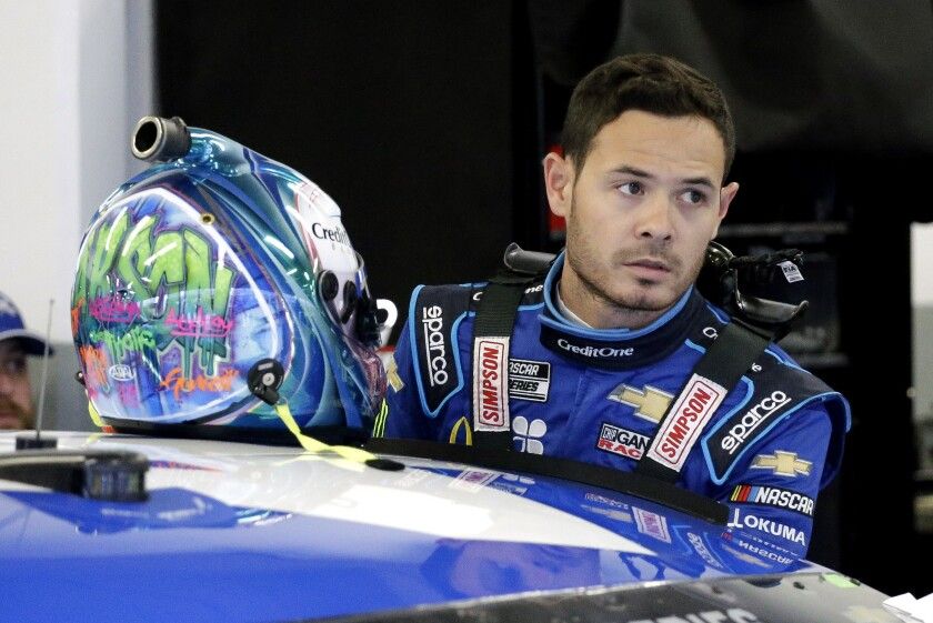 NASCAR driver Kyle Larson gets ready to climb into his car to practice for the Daytona 500 on Feb. 14.