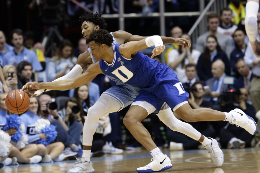 North Carolina guard Leaky Black, rear, and Duke forward Wendell Moore Jr. reach for a loose ball during the first half of an NCAA college basketball game in Chapel Hill, N.C., Saturday, Feb. 8, 2020. (AP Photo/Gerry Broome)