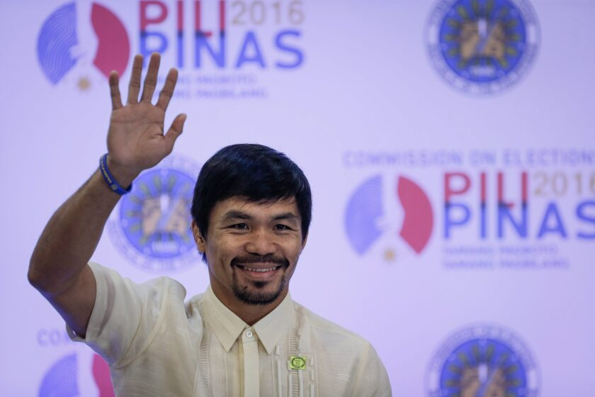 Manny Pacquiao waves to the crowd in Pasay, Philippines, on May 19 after winning a Senate seat.