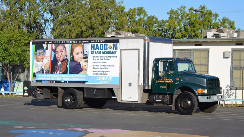 An L.A. Unified delivery truck displays an advertisement for Haddon Avenue STEAM Academy.