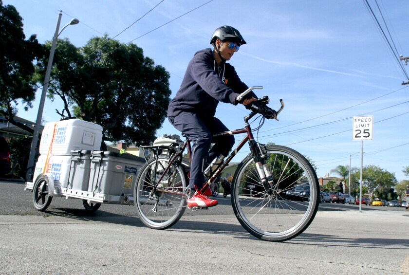 Food Riders of Orange Coast College past president Yousuf Elgohary helped pull a trailer loaded with coolers and containers of food during weekly delivery of food to Lighthouse Costa Mesa, in Costa Mesa on Wednesday, Nov. 23, 2016. Elgohary has made more than 100 of the weekly rides to deliver food, which is donated by OCC's cafeteria. Lighthouse Costa Mesa is a Church of the Nazarene that serves food and also hands out food to the needy.