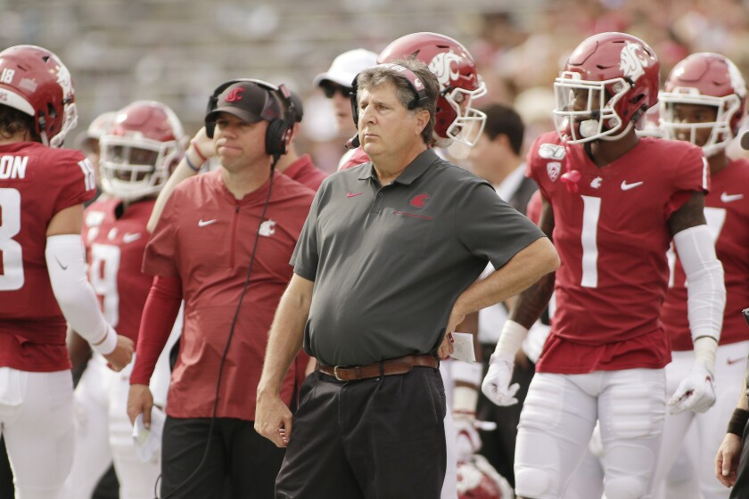 Washington State head coach Mike Leach, center, looks on during the first half against Northern Colorado in Pullman, Wash. on Sept. 7.