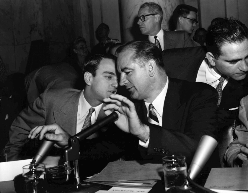 Sen. Joseph McCarthy speaks to his chief counsel, Roy Cohn, during the Senate's Army-McCarthy hearings in April 1954.