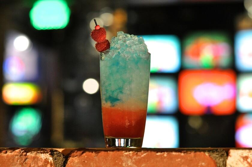 The Rock-It Pop drink from Break Room 86 has raspberry tea syrup, lemon juice, vodka and blue Curacao.
