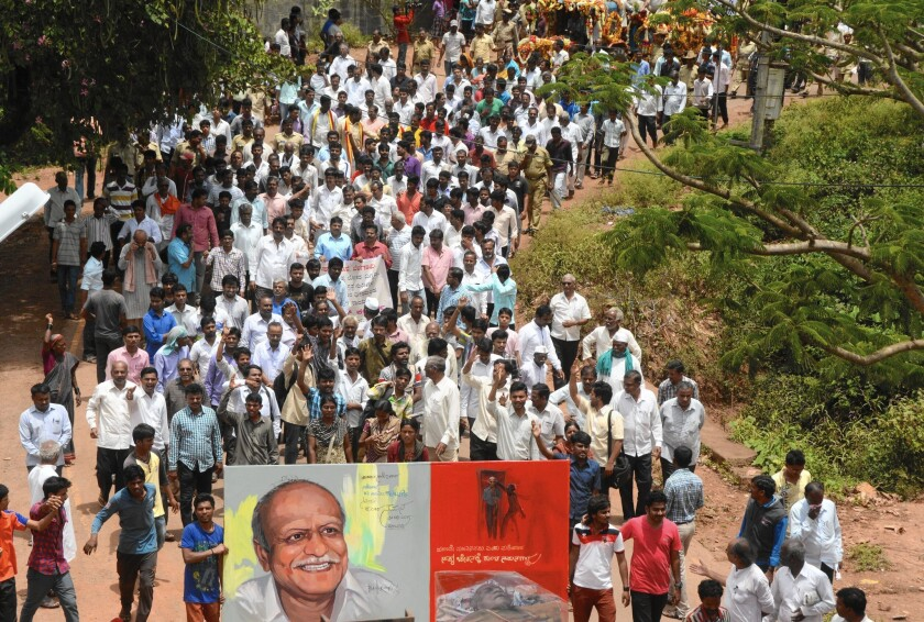 "The funeral procession for M.M. Kalburgi. Hours after Kalburgi was slain, a member of a militant Hindu group tweeted: ""Mock Hinduism and die a dog's death."""