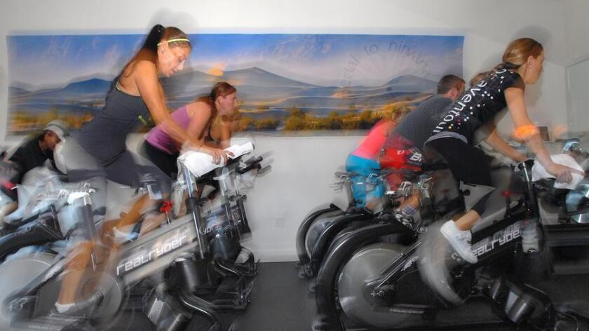 At Bonaventour Interactive Cycling Yoga Studio, cycling yogis flow through their spinning practice during the first portion of the studios signature Pedal to Nirvana class. (/ Rick Nocon)