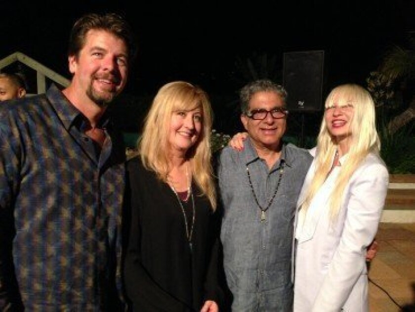 Steve and Kathleen Flynn, Deepak Chopra and musician Sia at the Chopra Foundation's Sages and Scientists event in August, in which the Graves' Disease and Thyroid Foundation took part.