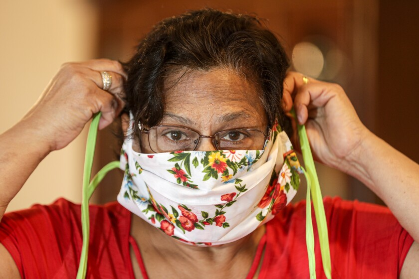 Bibi Sheonarine of Upland models a face mask that she sewed.