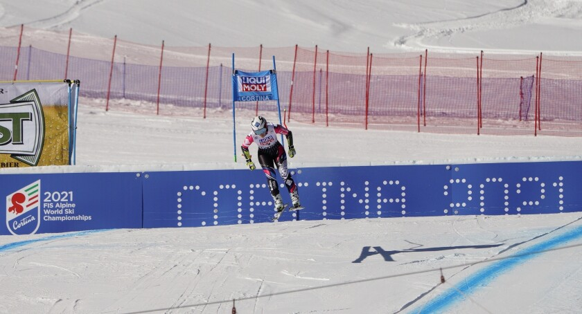 FILE - In this Jan. 20, 2019 file photo, Liechtenstein's Tina Weirather speeds down the course as a banner advertising the ski world championships in Cortina d'Ampezzo is seen in the background, during an alpine ski, women's World Cup super-G in Cortina D'Ampezzo, Italy. The International Ski Federation governing body on Thursday July 2, 2020, has rejected a request by Italian organizers of the 2021 Alpine ski world championships to postpone the competition by one year amid uncertainty during the pandemic. (AP Photo/Giovanni Auletta, file)