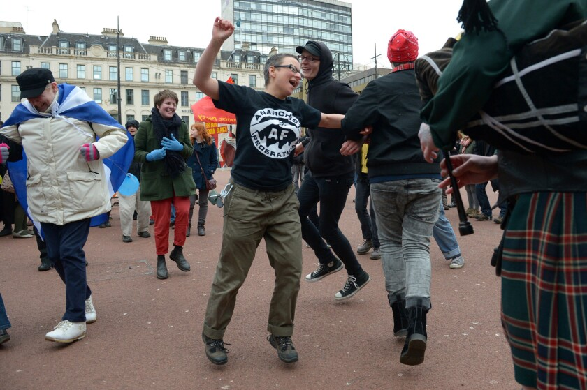 Critics of former Prime Minister Margaret Thatcher dance in George Square in Glasgow, Scotland, to mark her death Monday. Thatcher was not popular in much of northern Britain, especially among working-class residents of northern England, Scotland and Wales.