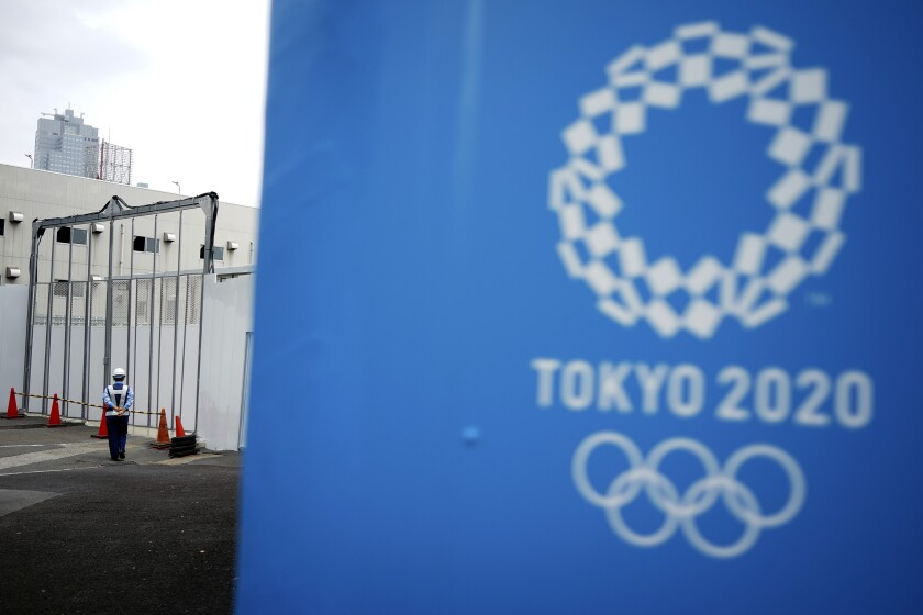 """FILE.- In this May 12, 2020, file photo, a lone security guard stands at one of the venues for the Tokyo 2020 Olympic Games in Tokyo. The head of the Tokyo Olympics on Friday, June 12, 2020, says that 80% of the facilities needed for next year's games have """"basic approval""""to be used. (AP Photo/Eugene Hoshiko, File)"""
