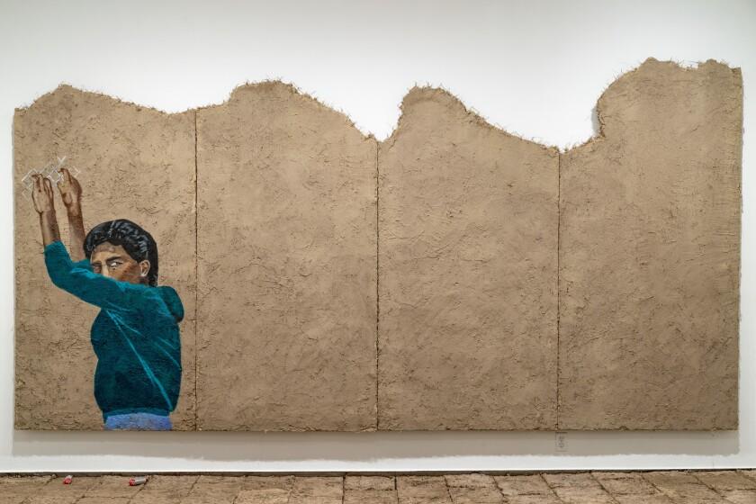 "Rafa Esparza's painting on adobe, ""...we are the mountain,"" 2019."