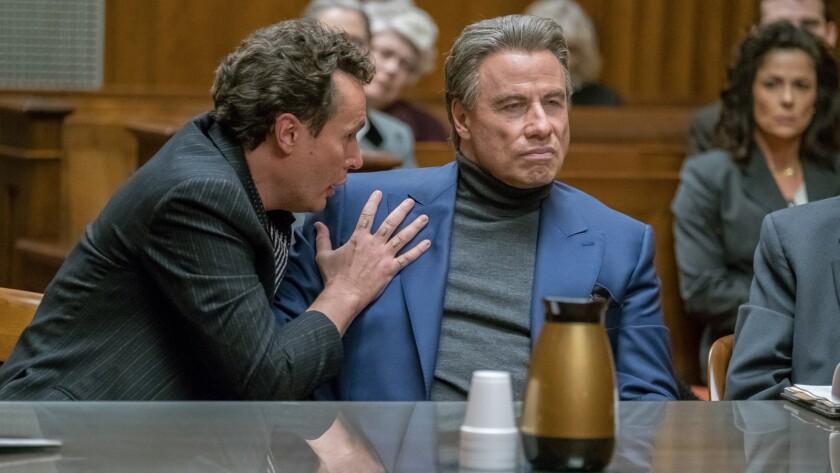 "Chris Kerson, left, and a terrific John Travolta in the movie ""Gotti."""