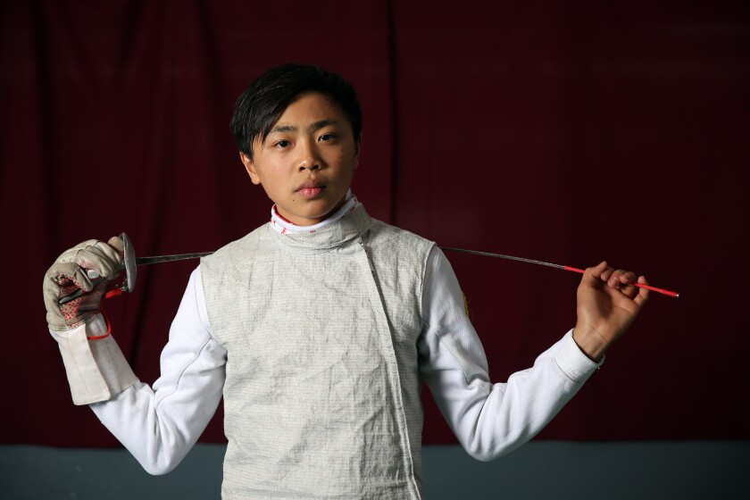 Bryce Louie poses for a portrait at the Los Angeles International Fencing Center.