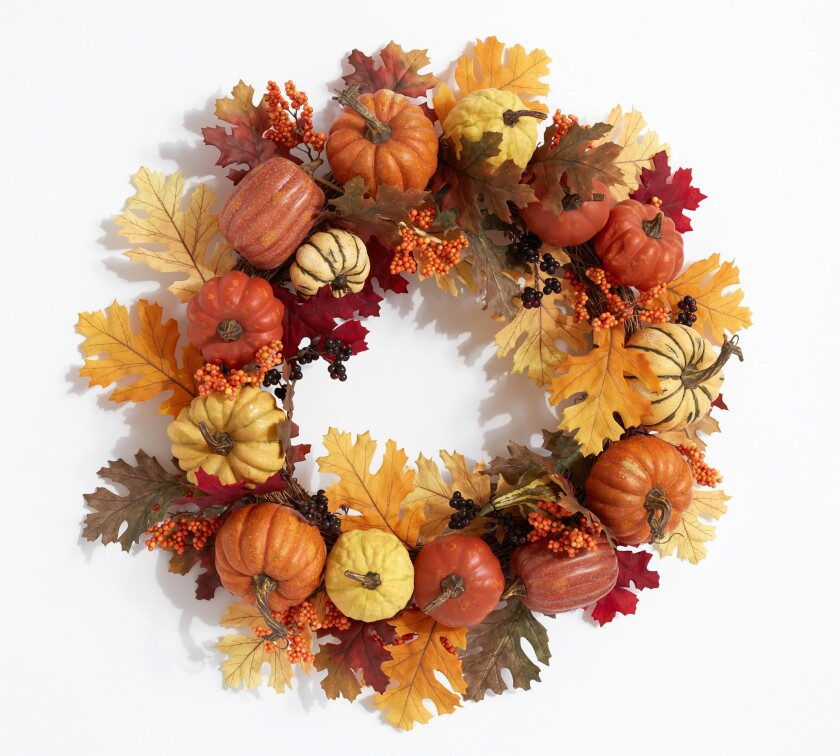 PSL fans welcome here: hang a faux harvest pumpkin wreath, $99 at Pottery Barn and invite the season