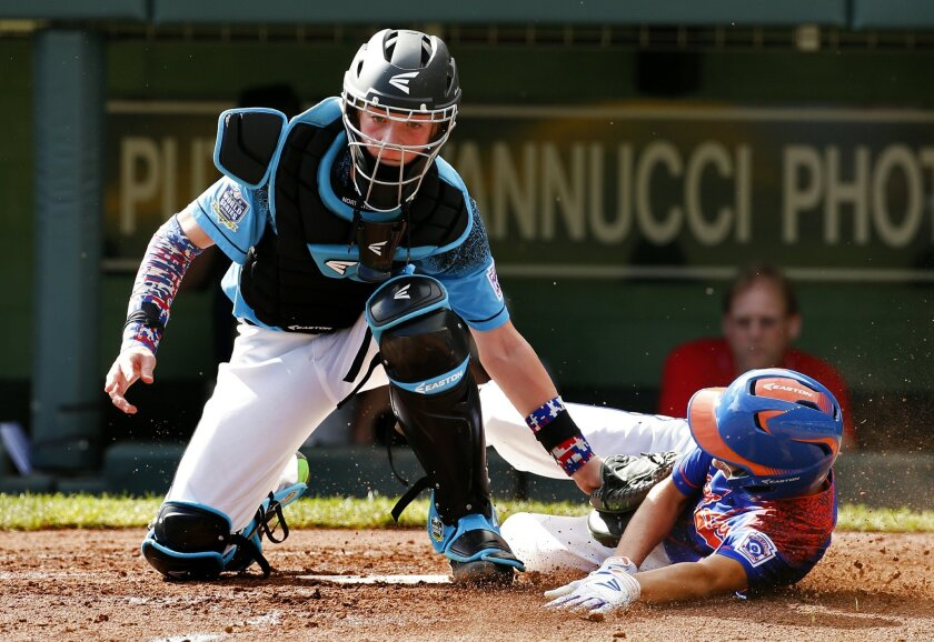 Portland, Oregon's Cooper Shaw tags out Bowling Green, Kentucky's Ty Bryant, who attempted to score on a single by Bowling Green, Kentucky's Tayshaun Jones, during the fourth inning of an United States elimination baseball game at the Little League World Series tournament in South Williamsport, Pa., Saturday, Aug. 22, 2015. (AP Photo/Gene J. Puskar)