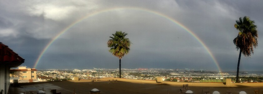 Rainbow appears over the Port of Los Angeles after rain drenched the area.
