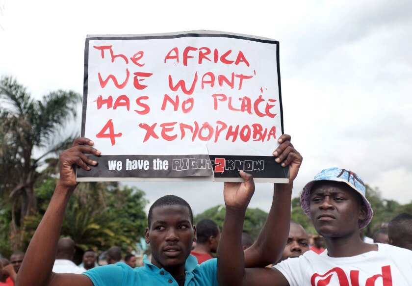 Foreign nationals hold a placard during an anti-xenophobia march outside Durban City Hall in South Africa on April 8.