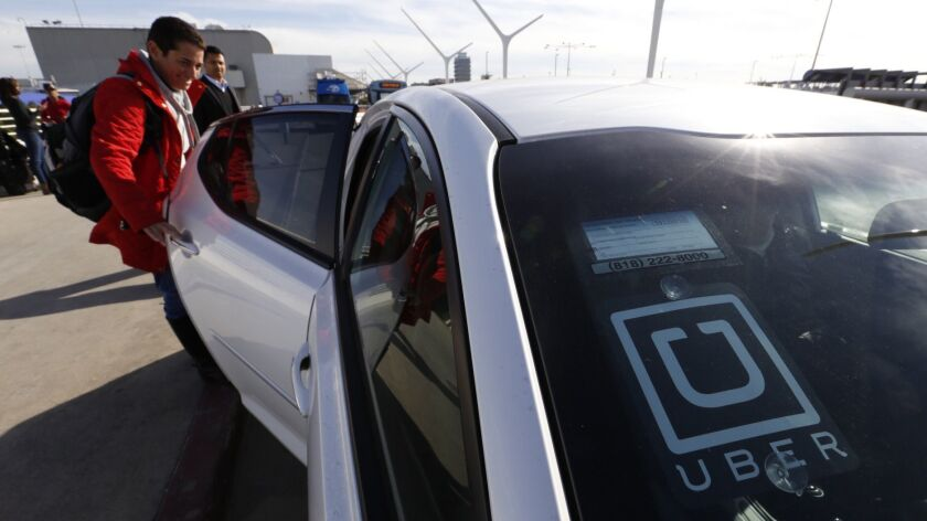 LOS ANGELES, CA - JANUARY 20, 2016 - Ronit Belson from the Bay Area catches her Uber car at Los Ange