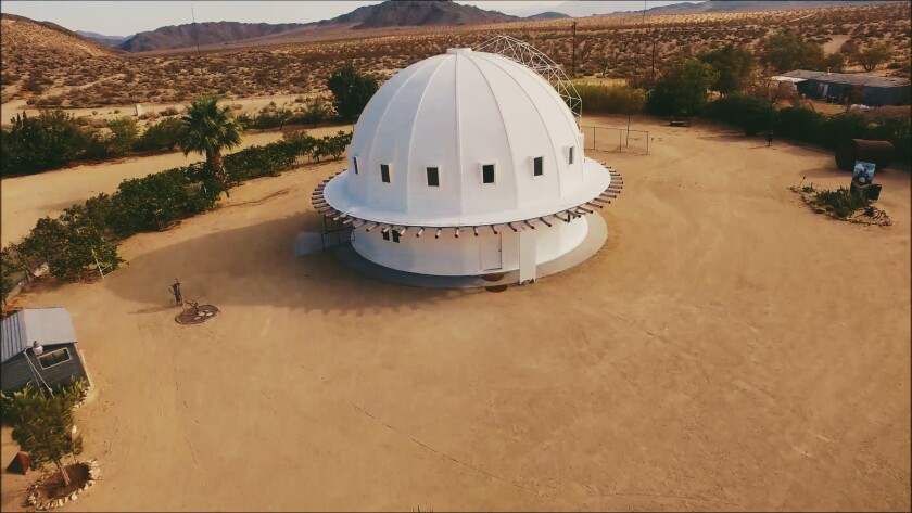 "The Integratron structure near Joshua Tree and its builder, 1950s-era space alien channeler George Van Tassel, are the subject of filmmaker Jonathan Berman's new documentary ""Calling All Earthlings."""