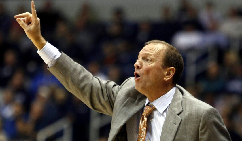 49ers Coach Dan Monson gives directors to his players during a 'buy' game at Xavier earlier this season.
