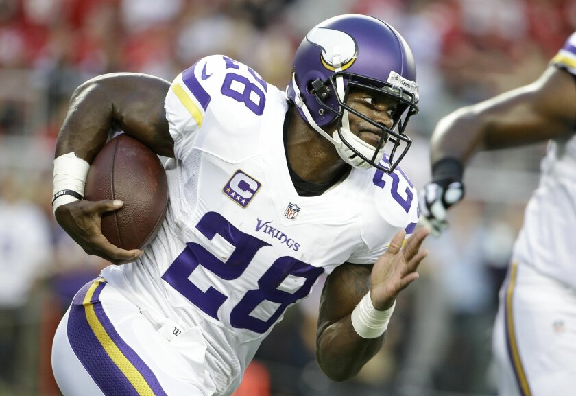 ADVANCE FOR WEEKEND EDITIONS, SEPT. 26-27 - FILE - In this Sept. 14, 2015, file photo, Minnesota Vikings running back Adrian Peterson (28) warms up before an NFL football game against the San Francisco 49ers in Santa Clara, Calif. The last time Minnesota hosted San Diego, a rookie named Adrian Peterson trampled the Chargers for an NFL-best 296 yards rushing. Now in his ninth season with the Vikings, Peterson still smiles at his recollections of setting a record that will be tough to break again in this pass-friendly league. (AP Photo/Marcio Jose Sanchez, File)