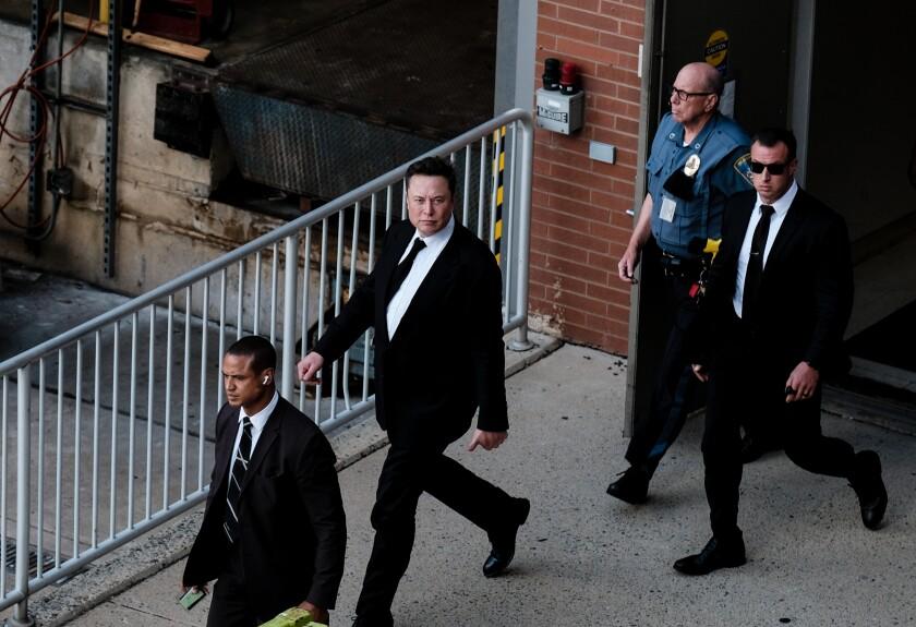Men leaving a building.