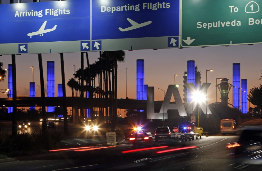 Lighted pylons add color to the Century Boulevard entrance to Los Angeles International Airport.