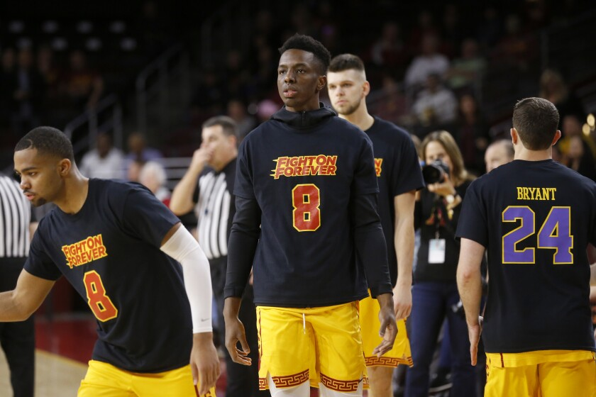 USC Trojans forward Onyeka Okongwu (21) wears a warm up tee-shirt in remembrance of Kobe Bryant before the start of a game against Utah at the Galen Center on Thursday.