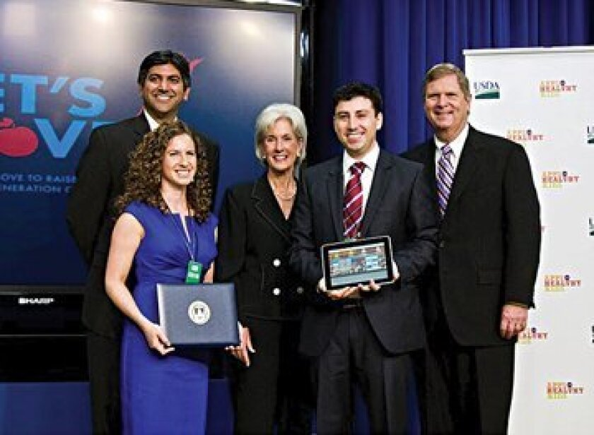 Aaron Coleman and Jesica Oratowski-Coleman (holding items) pose with White House Chief Technology Officer Aneesh Chopra, Health and Human Services Secretary Kathleen Sebelius and Agriculture Secretary Tom Vilsack. Photo: Courtesy